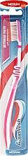 Духи, Парфюмерия, косметика Зубная щетка средней жесткости, розовая - Aquafresh Between Teeth Medium