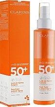 Духи, Парфюмерия, косметика Солнцезащитное молочко-спрей для тела - Clarins Lait-en-Spray Solaire Corps 50+